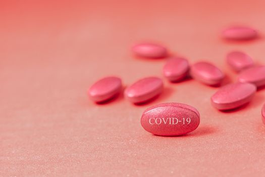Capsule pill Medicine Positive Coronavirus or COVID-19.Medicine Of viruses in laboratory for Prevention of a pandemic in Wuhan China. scientist in biological protective Epidemic virus outbreak concept