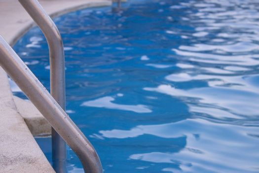 Swimming pool with stair closeup