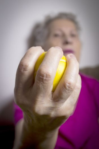 Rehabilitation exercises for an older woman with cerebral stroke