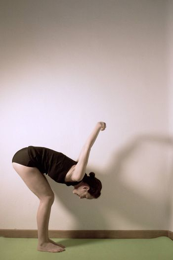Individual yoga practice performed by a woman