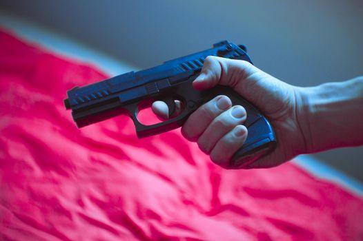 Firearm held by a man