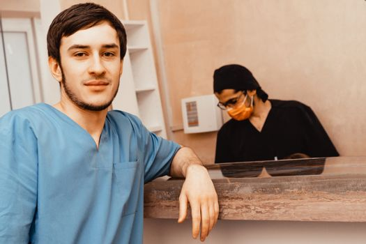 Male doctor in professional clothes at the clinic. Professional uniform and equipment of a dentist. Healthcare Equipping a doctors workplace. Dentistry.