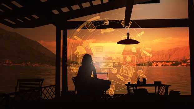 Girl writer working on a laptop at sunset.