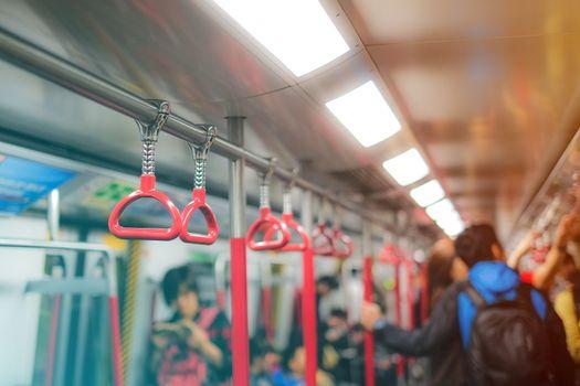 Handles for standing passenger in subway