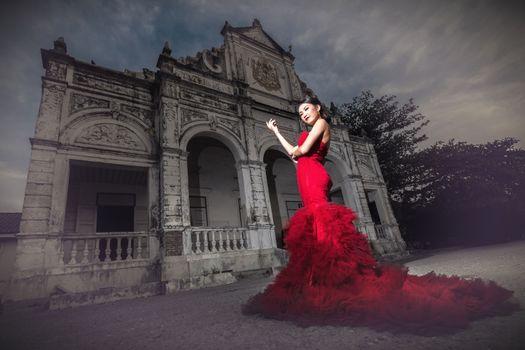 Beautiful woman wearing fashionable red dress