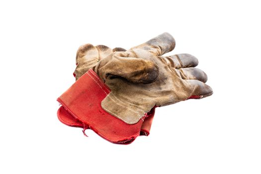 pair of construction gloves made of leather with worn red fabric on a white background