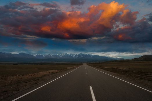 Empty route in Altai mountains with beauty sunset