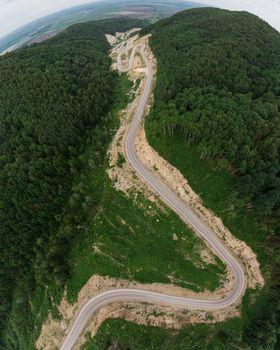 Aerial top vew of winding road in the mountains, drone shot. Altai Krai, Western Siberia, Russia. Road to Resort town Belokurikha 2