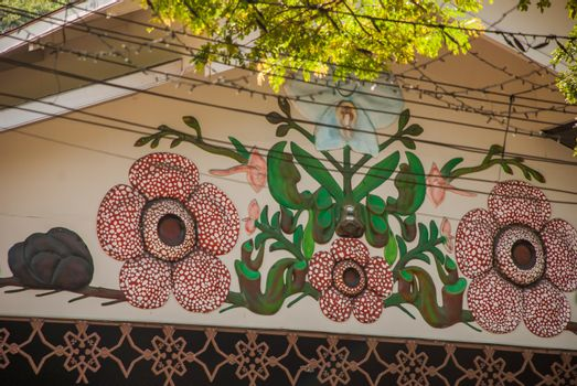 KOTA KINABALU, SABAH, MALAYSIA - MARCH 2017: House with a beautiful decoration in the form of flowers rafflesia.