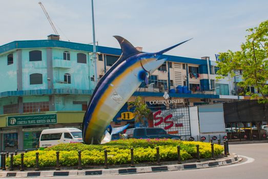 KOTA KINABALU, SABAH, MALAYSIA - MARCH 2017: The fish sculpture on the waterfront. landmark I Love KK pictured.