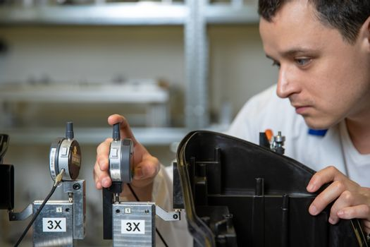 Scientists checking apparatus for accurate 3D measurements in a research laboratory