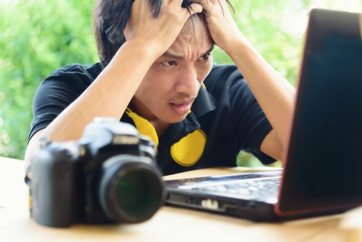 Photographer be nervous with job in notebook