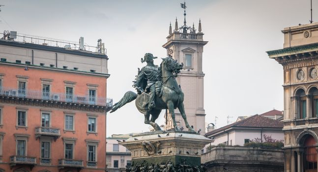 Milan, Italy - November 2, 2017: Monument in honor of Victor Emmanuel II which is in Piazza del Duomo commissioned by the Italian sculptor Ercole Rosa by the King of Italy Humbert I in 1878