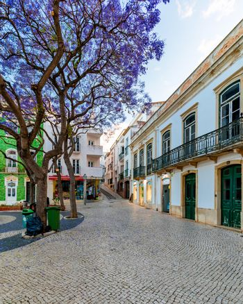 Street in the old town in the center of Lagos, Algarve region, Portugal. Narrow street in Lagos, Algarve, Portugal. Streets in the historic old town of Lagos, Algarve, Portugal.