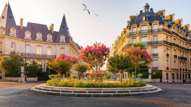 Typical view of the Parisian street in Paris, France. Architecture and landmark of Paris. Beautiful view of the street with flowers and architecture in Paris, France.