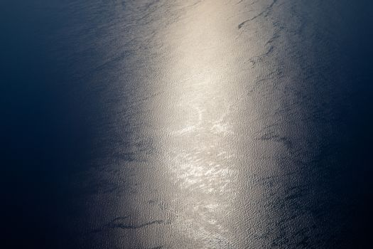 Sunlight twinkling and reflecting off sea water. Sparkles on wat
