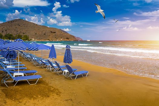 View of sunbeds awaiting tourists at the Greek island resort of