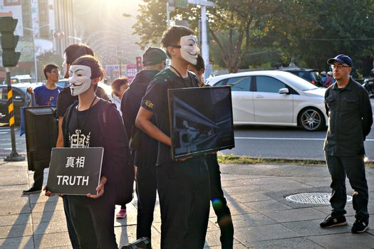 KAOHSIUNG, TAIWAN -- DECEMBER 14, 2019: Demonstrators at a busy intersection in downtown protest against cruelty in the livestock industry.