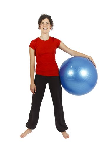 Young woman with a blue yoga ball.