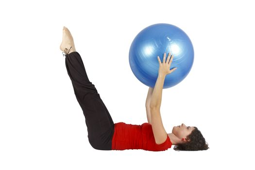 Young woman raising legs while she holds a blue yoga ball.