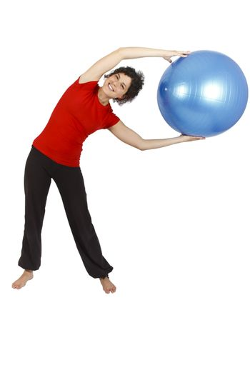 Young woman doing some exercise with a blue yoga ball.