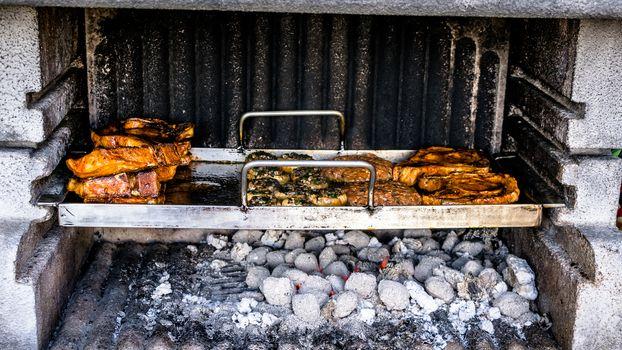Preparation of a BBQ - wood burned down - charcoal at maximum heat
