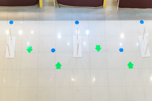 social distancing sign at the floor for shopping Queue