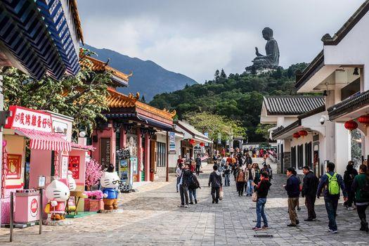 HONG KONG - JANUARY 13, 2016: Tian Tan Buddha aka the Big Buddha is a large bronze statue of a Sakyamuni Buddha and located at Ngong Ping Lantau Island in Hong Kong.