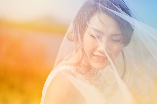 Woman smiling with perfect smile in Veil and sunlight