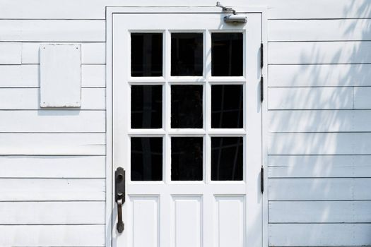 Door in the wood white wall