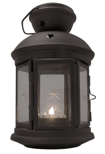 Vintage lantern with candle isolated on white background. Clipping path included.