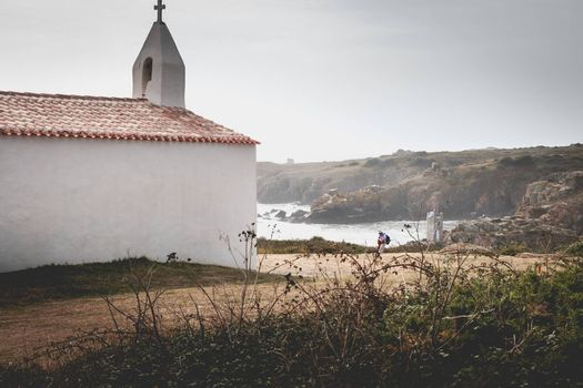 La Meule, France - September 18, 2018: Tourists visiting the surroundings of La Meule chapel near the marina on the island of Yeu