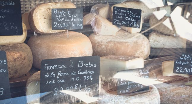 Saint Lary Soulan, France - August 20, 2018 : Showcase of a small cheese merchant on a mountain market on a summer day