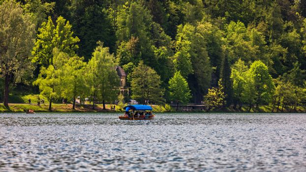Iconic Bled scenery. Boats at lake Bled, Slovenia, Europe. Wooden boats on the Island on Lake Bled, Slovenia