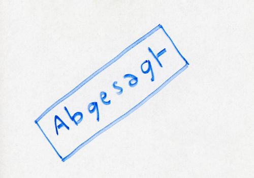 Abgesagt ( translation Cancelled) stamp handwritten with blue felt tip pen