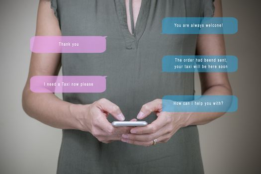 Woman (44 years old) chatting with chatbot on smartphone - ordering a taxi