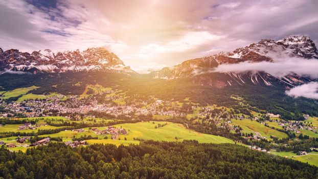 Cortina d'Ampezzo town panoramic view with alpine green landscap