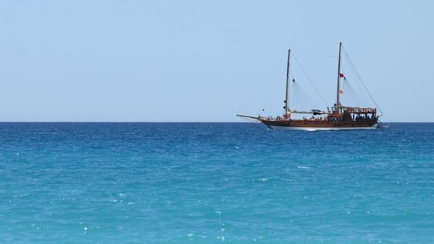 Cruise yacht in the Mediterranean Sea. Panoramic photo.