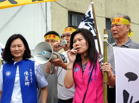 KAOHSIUNG, TAIWAN -- JULY 31 , 2017: Politicians of the opposition Kuomintang join protesters at the opening of a controversial new road.