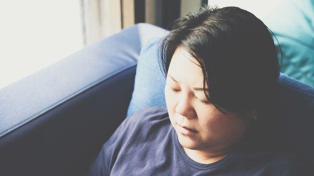 Asia women 40s white skin thinking on sofa
