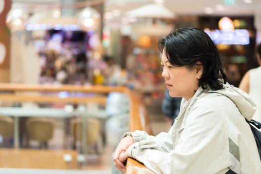 Asian women 40s white skin in shopping mall