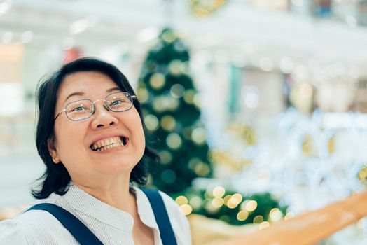 Asian woman 40s white skin in shopping mall