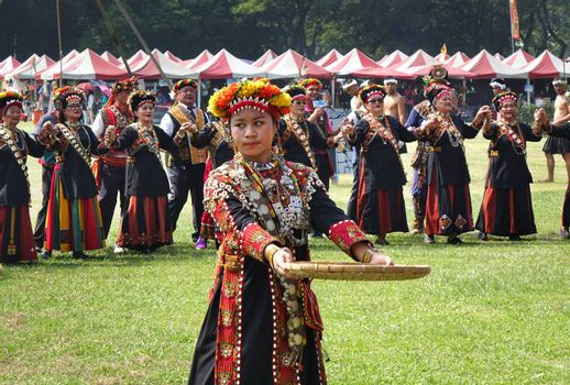 KAOHSIUNG, TAIWAN -- SEPTEMBER 28, 2019: Women of the indigenous Rukai tribe perform a dance during the traditional harvest festival.