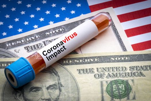 CORONAVIRUS IMPACT text, US Dollar and blood sample vacuum tube on America flags background. Covid-19 or Coronavirus Concept