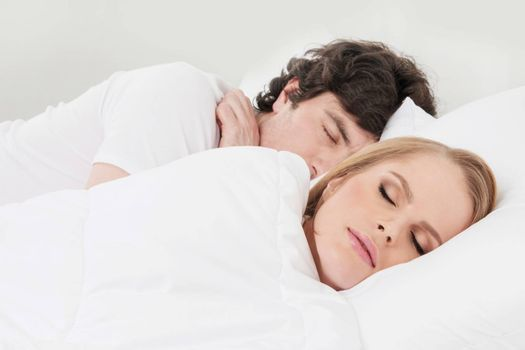 Portrait of couple sleeping in the bed close up focus on woman