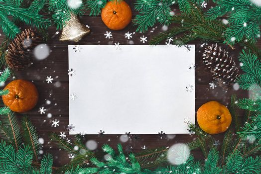 Christmas background for greetings, fir branches, paper, snowflakes, cones, bell, citrus and decor