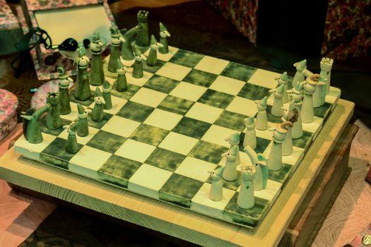 Beautiful Italian handmade wooden chess on chessboard