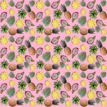 Exotic fruits and tropical palm leaves on pink background. Summer fruits pattern of pineapple, dragon fruit and palm leaves.