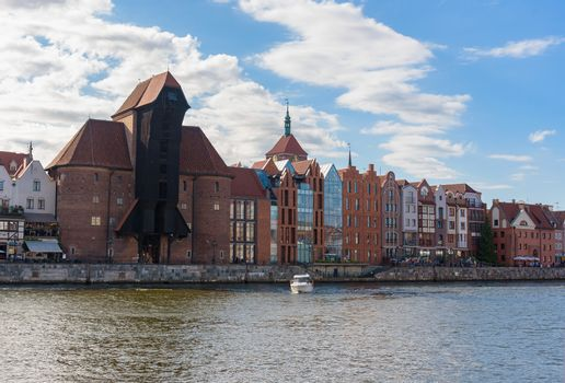 Riverside promenade in the old town of Gdansk with famous medieval port crane