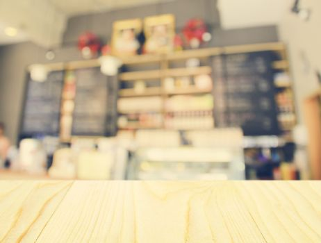 Empty wooden table and blurred cafe background